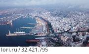 Купить «Aerial panorama of Almeria cityscape and vessels in harbor, Andalusia, Spain», видеоролик № 32421795, снято 22 мая 2019 г. (c) Яков Филимонов / Фотобанк Лори
