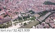 Купить «Aerial view of Valladolid cityscape with a modern apartment buildings, Spain», видеоролик № 32421939, снято 20 июня 2019 г. (c) Яков Филимонов / Фотобанк Лори