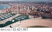Купить «Panoramic aerial view of Gijon on Atlantic ocean coast overlooking of marina with moored pleasure yachts, Spain», видеоролик № 32421967, снято 15 июля 2019 г. (c) Яков Филимонов / Фотобанк Лори