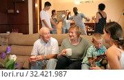 Купить «Three generations of happy international family celebrating family holiday together, communicating and dancing at home», видеоролик № 32421987, снято 17 августа 2019 г. (c) Яков Филимонов / Фотобанк Лори