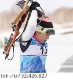 Купить «Sportswoman biathlete Yu Seolhee (South Korea) puts on rifle behind his back after firing at shooting range», фото № 32426827, снято 12 апреля 2019 г. (c) А. А. Пирагис / Фотобанк Лори