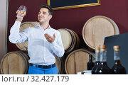 Купить «Portrait of man enjoying liquor sample in glass», фото № 32427179, снято 4 апреля 2020 г. (c) Яков Филимонов / Фотобанк Лори