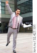 Happy business man celebrating success. Стоковое фото, фотограф Яков Филимонов / Фотобанк Лори