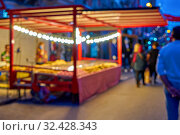 Купить «Defocused crowd of people during Christmas fair an old town street with colorful Christmas lights», фото № 32428343, снято 27 октября 2018 г. (c) Kira_Yan / Фотобанк Лори