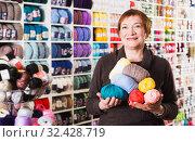 Купить «Woman in needlework shop», фото № 32428719, снято 10 мая 2017 г. (c) Яков Филимонов / Фотобанк Лори
