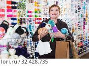 Купить «Woman with accessories for needlework», фото № 32428735, снято 10 мая 2017 г. (c) Яков Филимонов / Фотобанк Лори