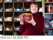 Купить «Woman with basket of candies», фото № 32428751, снято 15 декабря 2017 г. (c) Яков Филимонов / Фотобанк Лори