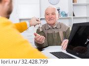Купить «Man buying house in office», фото № 32428799, снято 22 ноября 2019 г. (c) Яков Филимонов / Фотобанк Лори