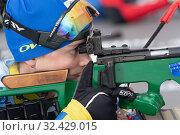 Купить «Close-up view of biathlete Arina Kryukova Kazakhstan rifle shooting in prone position. Biathlete in shooting range», фото № 32429015, снято 12 апреля 2019 г. (c) А. А. Пирагис / Фотобанк Лори