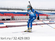 Sportswoman biathlete Soldatova Arina (Kamchatka Region) skiing on distance biathlon stadium (2019 год). Редакционное фото, фотограф А. А. Пирагис / Фотобанк Лори