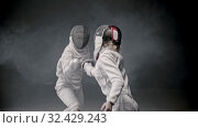Купить «Fencing training - two young woman having a duel between each other», видеоролик № 32429243, снято 1 апреля 2020 г. (c) Константин Шишкин / Фотобанк Лори