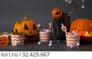 Купить «pumpkins, candies and halloween decorations», видеоролик № 32429667, снято 14 ноября 2019 г. (c) Syda Productions / Фотобанк Лори
