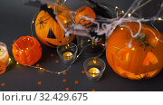 Купить «pumpkins, candles and halloween decorations», видеоролик № 32429675, снято 14 ноября 2019 г. (c) Syda Productions / Фотобанк Лори