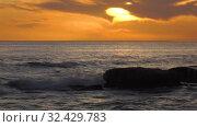Купить «Каспийское море на закате. Волны набегают на скалистый берег. Caspian Sea at sunset. Waves run onto a rocky shore.», видеоролик № 32429783, снято 7 февраля 2019 г. (c) Евгений Романов / Фотобанк Лори