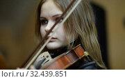 Купить «Ufa, RUSSIA - NOVEMBER 19, 2015: Symphony Orchestra at the Bashkir Theater of Opera and Ballet, Ufa», видеоролик № 32439851, снято 19 ноября 2015 г. (c) Mikhail Erguine / Фотобанк Лори