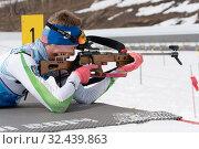 Купить «Sportsman biathlete Rusinov Vladislav Khanty-Mansiysk rifle shooting in prone position. Biathlete in shooting range», фото № 32439863, снято 12 апреля 2019 г. (c) А. А. Пирагис / Фотобанк Лори
