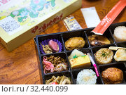 Bento is a single-portion take-out or home-packed meal common in Japanese cuisine. Bento lunch boxes convenient for travel by train and other places throughout Japan (2013 год). Редакционное фото, фотограф Кекяляйнен Андрей / Фотобанк Лори