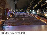 Купить «Colorful and animated stairway of Kyoto station concourse in west and east ends viewed from lower level. It is a major railway station and transportation hub. Киото, Япония», фото № 32440143, снято 12 апреля 2013 г. (c) Кекяляйнен Андрей / Фотобанк Лори