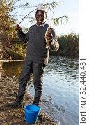 Купить «Fishing rod with fish on hook», фото № 32440431, снято 27 января 2019 г. (c) Яков Филимонов / Фотобанк Лори