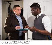 Купить «Men with documents indoor talk about the services offered», фото № 32440627, снято 26 февраля 2018 г. (c) Яков Филимонов / Фотобанк Лори