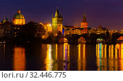 Evening view of Charles Bridge with illumination. Prague. Czech Republic. Стоковое фото, фотограф Яков Филимонов / Фотобанк Лори