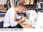 Dressmaker making clothes with sewing machine. Стоковое фото, фотограф Яков Филимонов / Фотобанк Лори