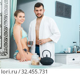 Купить «couple relaxing and drinking tea after spa treatments», фото № 32455731, снято 24 апреля 2018 г. (c) Яков Филимонов / Фотобанк Лори