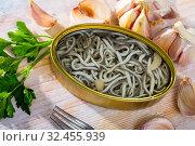 Купить «Can of natural elvers in garlic pickle», фото № 32455939, снято 29 марта 2020 г. (c) Яков Филимонов / Фотобанк Лори