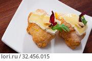 Купить «Dessert of french cuisine, mini croissant with camembert cheese», фото № 32456015, снято 16 июля 2020 г. (c) Яков Филимонов / Фотобанк Лори