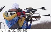 Купить «Group sportsmans biathlete rifle shooting, reloading rifle in standing position», видеоролик № 32456143, снято 12 апреля 2019 г. (c) А. А. Пирагис / Фотобанк Лори