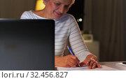 Купить «happy senior woman with laptop at home in evening», видеоролик № 32456827, снято 18 ноября 2019 г. (c) Syda Productions / Фотобанк Лори