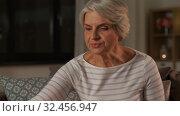 Купить «senior woman reading book and drinking tea at home», видеоролик № 32456947, снято 18 ноября 2019 г. (c) Syda Productions / Фотобанк Лори