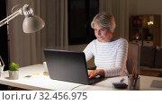 Купить «senior woman with laptop drinking coffee at home», видеоролик № 32456975, снято 18 ноября 2019 г. (c) Syda Productions / Фотобанк Лори