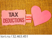 Купить «Text sign showing Tax Deductions. Conceptual photo Reduction on taxes Investment Savings Money Returns Text pink torn note equals is pink heart love message letter cute couple», фото № 32463451, снято 5 августа 2020 г. (c) easy Fotostock / Фотобанк Лори