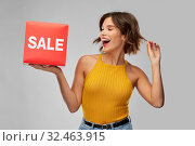 Купить «happy smiling young woman posing with sale sign», фото № 32463915, снято 30 сентября 2019 г. (c) Syda Productions / Фотобанк Лори