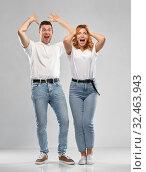 Купить «portrait of happy couple in white t-shirts», фото № 32463943, снято 6 октября 2019 г. (c) Syda Productions / Фотобанк Лори