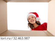 Купить «happy young woman looking into open christmas gift», фото № 32463987, снято 9 декабря 2018 г. (c) Syda Productions / Фотобанк Лори