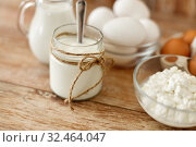 cottage cheese, yogurt, milk and chicken eggs. Стоковое фото, фотограф Syda Productions / Фотобанк Лори