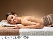 Купить «woman lying with sea salt on skin at spa», фото № 32464059, снято 13 октября 2019 г. (c) Syda Productions / Фотобанк Лори