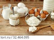 Купить «cottage cheese, yogurt, milk and chicken eggs», фото № 32464095, снято 16 августа 2018 г. (c) Syda Productions / Фотобанк Лори