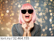 Купить «happy woman in pink wig and black sunglasses», фото № 32464155, снято 30 сентября 2019 г. (c) Syda Productions / Фотобанк Лори