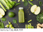 Купить «close up of bottle with green juice and vegetables», фото № 32464191, снято 12 апреля 2018 г. (c) Syda Productions / Фотобанк Лори