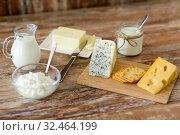 Купить «cottage cheese, crackers, milk, yogurt and butter», фото № 32464199, снято 16 августа 2018 г. (c) Syda Productions / Фотобанк Лори