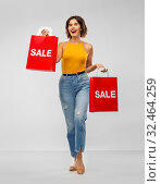 Купить «happy smiling young woman with shopping bags», фото № 32464259, снято 30 сентября 2019 г. (c) Syda Productions / Фотобанк Лори