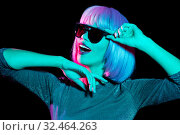 Купить «happy woman in pink wig and sunglasses dancing», фото № 32464263, снято 30 сентября 2019 г. (c) Syda Productions / Фотобанк Лори