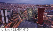 Купить «Panoramic aerial view of illuminated business district of Barcelona with modern skyscrapers at twilight», видеоролик № 32464615, снято 12 апреля 2019 г. (c) Яков Филимонов / Фотобанк Лори