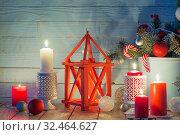 Купить «Christmas decorations with burning candles on blue wooden backgr», фото № 32464627, снято 14 ноября 2019 г. (c) Майя Крученкова / Фотобанк Лори