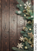 Купить «fir branches with Christmas decor on old dark wooden background», фото № 32464643, снято 14 ноября 2019 г. (c) Майя Крученкова / Фотобанк Лори