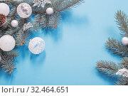 Купить «Christmas decorations on blue paper background», фото № 32464651, снято 18 ноября 2019 г. (c) Майя Крученкова / Фотобанк Лори