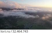 Купить «Unique landscape of Picos de Europa with rocky mountain ranges in thick clouds during sundown, Spain», видеоролик № 32464743, снято 14 июля 2019 г. (c) Яков Филимонов / Фотобанк Лори